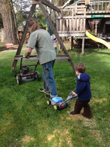Xylus and Dad mowing